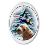 schnoodle posing in front of a decorated woodland tree. Use on your tree or as a gift topper.