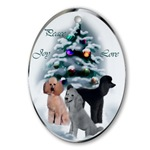 Stunning poodle Christmas ornaments featuring a black, a silver, and an apricot poodle standing proudly in a winer wonederland forest